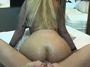 Blonde having a fat butt straddling a pole that is rigid