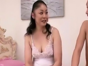 Buxom Asian mom has a younger man giving her body the care