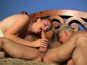Frisky young blonde is eager to suck on this hunk's rigid cum gun