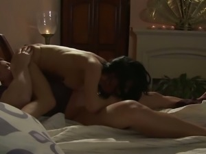 Loving couple is having passionate oral sex before going to sleep