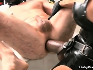 Mistress sticks a foot up his ass and then strapon fucks with a huge dildo