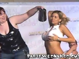 A bunch of smoking hot girls take off their clothes for the wet T-shirt contest