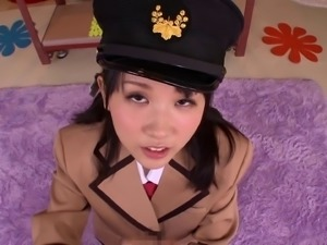Asian cutie wearing an uniform getting her face decorated with cum