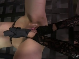 Pretty brunette is getting her pussy fisted while totally tied up