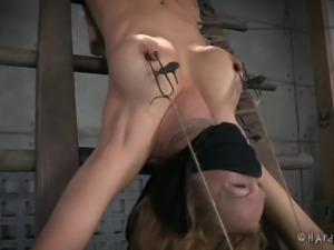 Rough bondage session for a blonde with a tattooed thigh