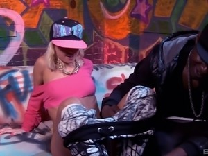 Adrenalizing blonde rides the black cock in the colorful room