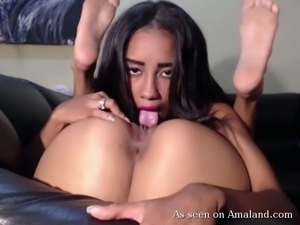 Naughty and young latina eats her pal in front of camera
