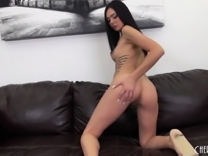 Attractive brunette with sexy legs toys and fingers her shaved pussy