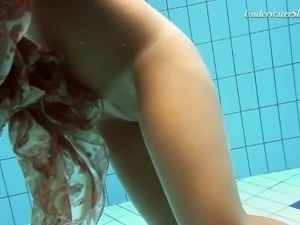 Skinny teen swimming naked in a pool in amateur video