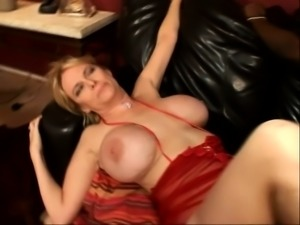 Luscious blonde with big hooters surrenders her pussy to a black stud
