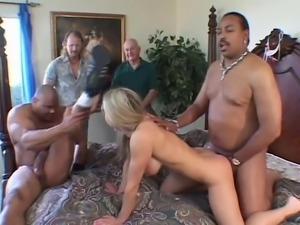 Blindfolded blonde fucks a couple of guys while two hunks look at her