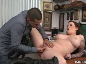 A wild slut in a knee high boots bent over a table and fucked