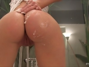 Naughty lady plays with her dripping wet shaved tunnel of love