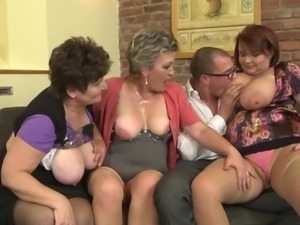 Fit guy in business clothes gets naked to fuck three old chicks