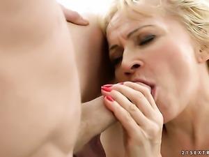 Blonde takes dildo in her deadeye after sexy striptease