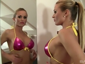 Fantastic blonde babe in shiny lingerie sucks dick and fucks on the bed