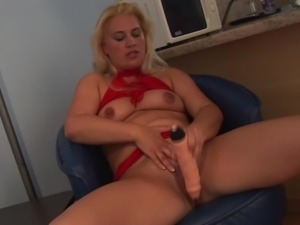 Rubbing her big clit with a toy that brings her a lot of pleasure