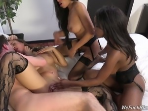 Gorgeous and wild young ebony babes on the bed call a white guy to fuck