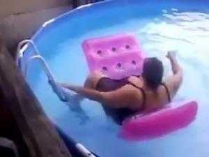 BBW mom falls off a raft in the pool