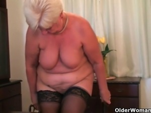 Highly sexed grandma Sandie rubs her pierced clit