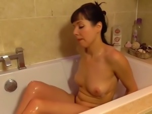 Lovely MILF going to bath