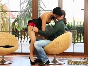 Clothed ho pees on dude