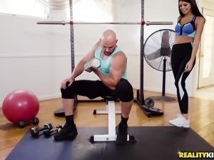 Fit brunette Olivia Lua bends over for a man's boner