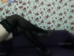 Brunette in stockings drilling stud with strapon