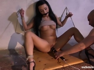 Daphne Klyde tied up during a nasty BDSM session with a sex toy