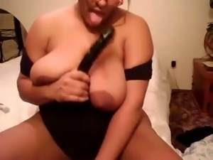 This crazy housewife fucks her worn out twat again in front of a web-camera