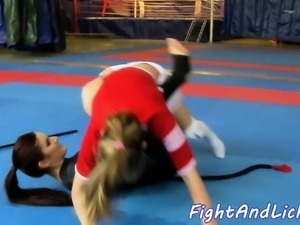 Wrestling dyke pussylicked by cheerleader