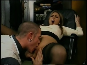 Two men making a sexy secretary scream on the desk