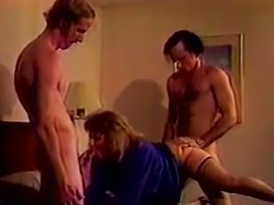 Blonde cougar on the bed having wild hardcore threesome