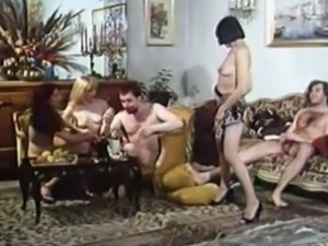 Blonde and brunette young chicks having orgy with their friends