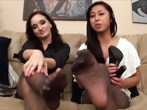 Two Employees Tease In Pantyhose