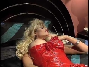 Blonde in a red sexy outfit spreads her legs for a masturbation game