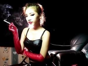 Smoking Fetish Doll posing