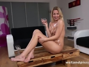 Busty slutty bitch Nikki Dream pisses into glasses and pours urine onto tits