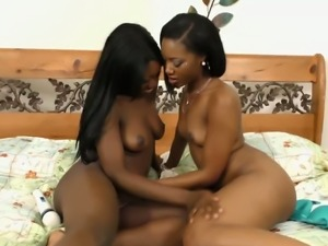 Two very hot ebony dykes enjoy pussy licking and playing with a vibrator