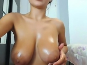 Hot babe with perfect big boobs taking shower