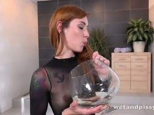 Tall and leggy temptress Foxie T licks her piss off the floor