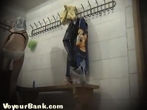 Cute brunette college girl in the locker room filmed topless