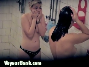 Busty blondie and her brunette friend spied in the shower