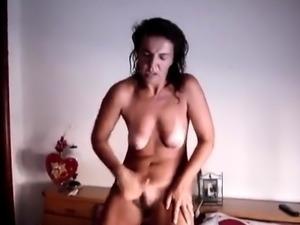 Horny brunette milf masturbates on cam