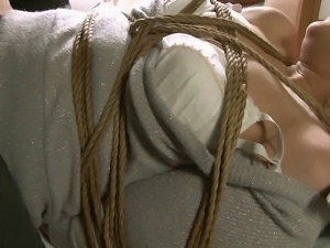 Rope binds the body of a cute Japanese milf taking dick