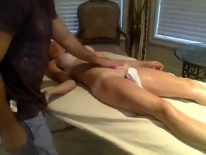 Lucky masseur has a busty brunette sucking his big shaft