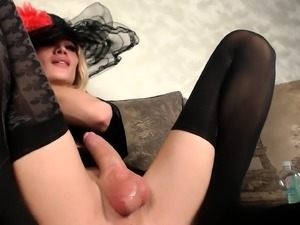 Enticing blonde shemale pleases her big cock with a sex toy