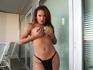 Fabulous tanned big breasted Tgirl Nicolly Nogueira wanks her own dick
