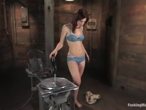 Riley Shy gets banged by a fucking machine in a wooden shed