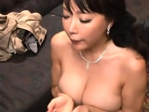 Buxom Asian mom has a guy fucking the hell out of her cunt